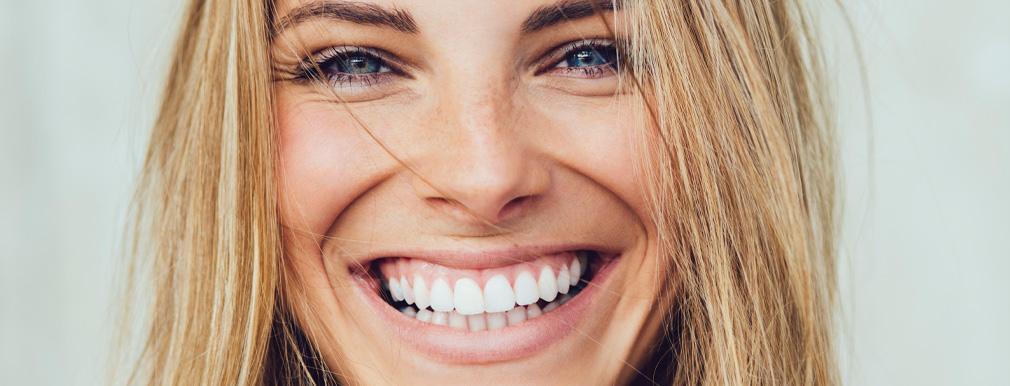 closeup of a woman's bright white smile